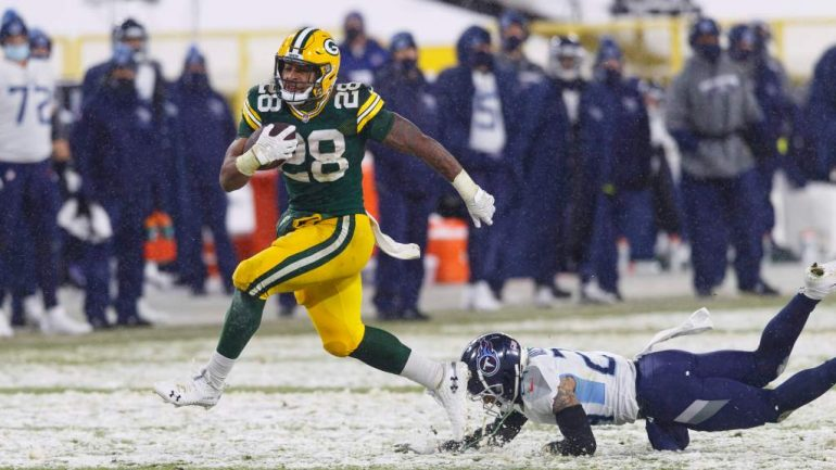 Upcoming Packers AJ Dillon shines in a landslide victory over the Titans