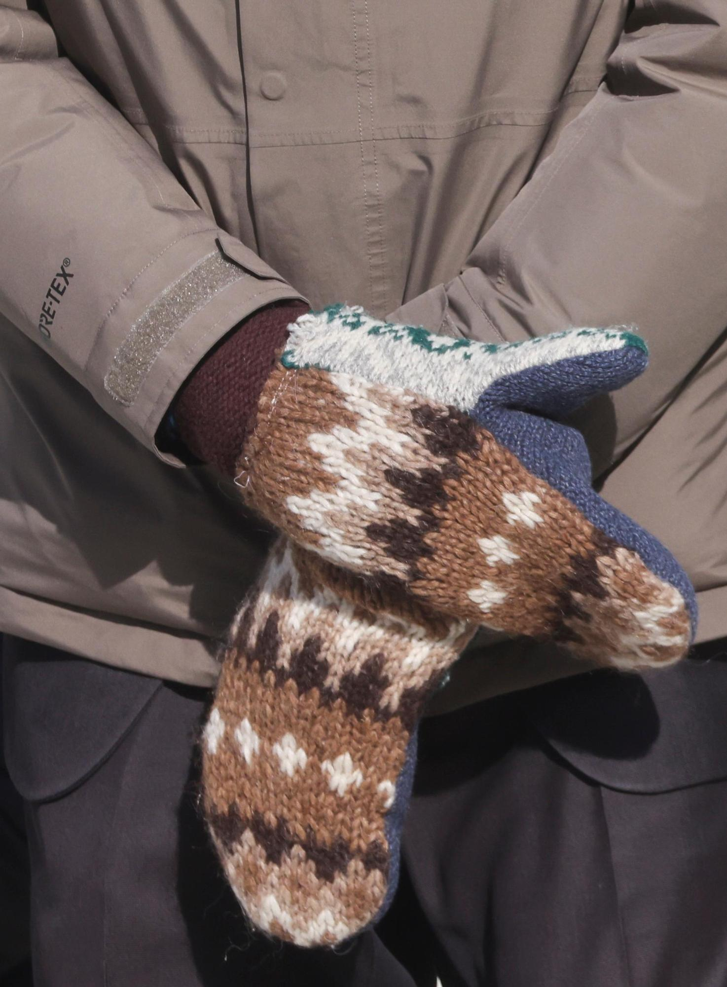 Sanders crossed the eye-catching knit mittens in his lap.
