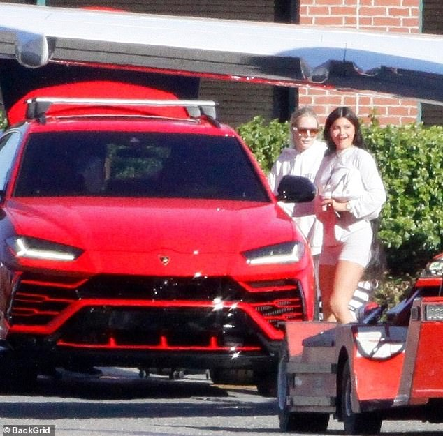 Travel in style: Kylie Jenner is spotted flying to her private jet in Los Angeles on Tuesday afternoon in a red Lamborghini