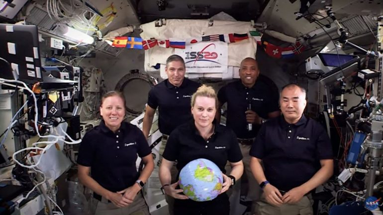 NASA's International Space Station crew flies into space for the New Year - with the tilt of zero gravity