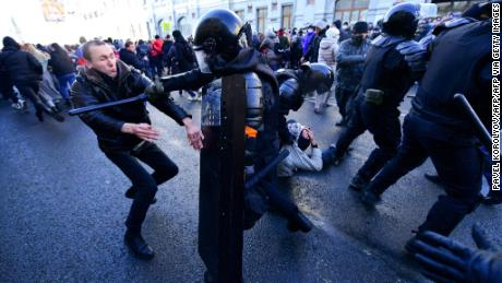 Protesters clash with riot police during a march in Vladivostok on January 23, 2021.