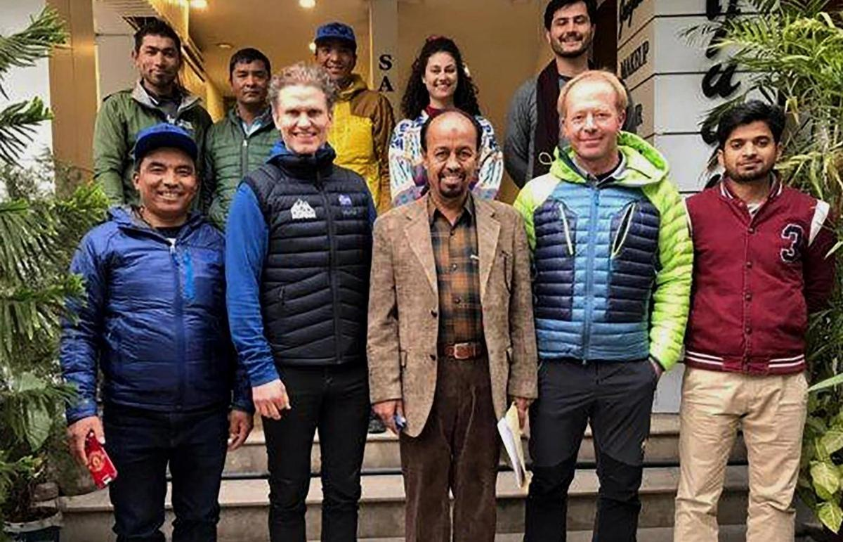 Missing: Mountaineer John Snorri from Iceland (front, second from left) and his team stand with Karrar Haider (center forward), a senior official of the Pakistan Alpine Club, in Islamabad, Pakistan.