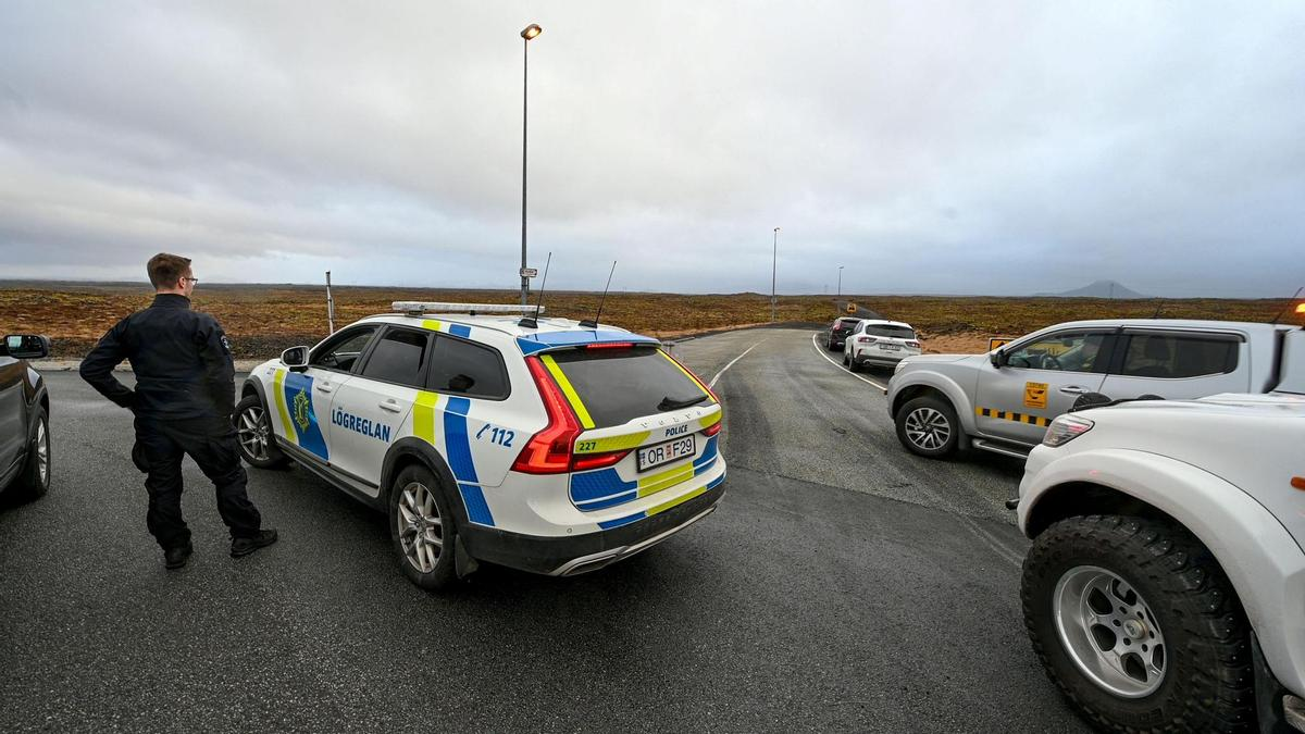 Police cordoned off a road in the area around the Little Hartur and Keeler Mountains.  (March 3, 2021)
