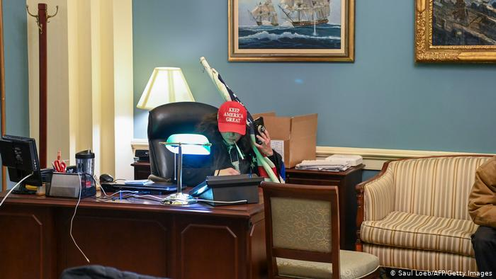A Trump supporter occupies the office of a deputy on the Capitol
