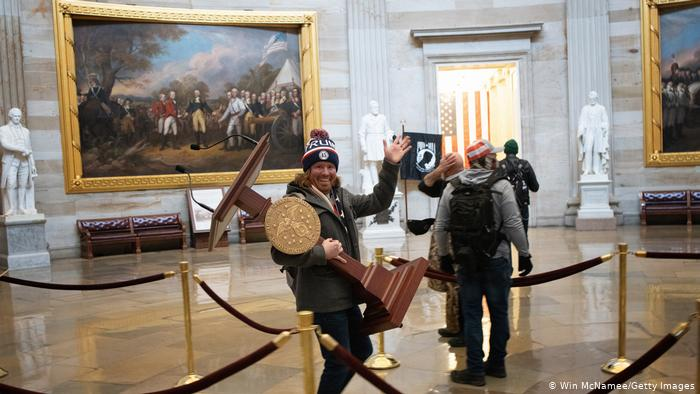 Washington 1 An intruder carries the pulpit away from House Speaker Nancy Pelosi