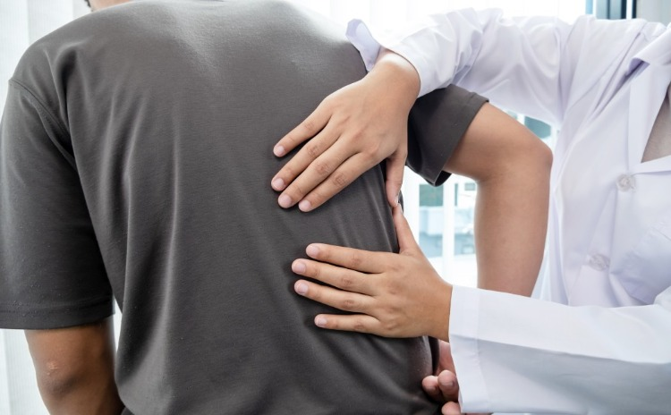 A patient with back pain is treated by a specialist