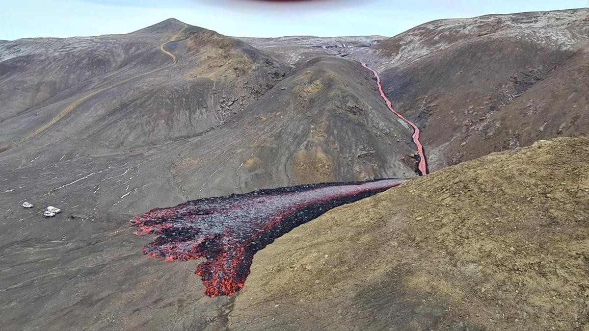 The image released by the Icelandic Civil Protection Agency shows a lava flow emerging from new fissures near Fagradalsfjall volcano.