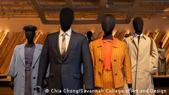 Four black models wearing outfits from the movie Salma are borrowed from 1960s fashions, like an orange outfit with a high-waisted skirt.