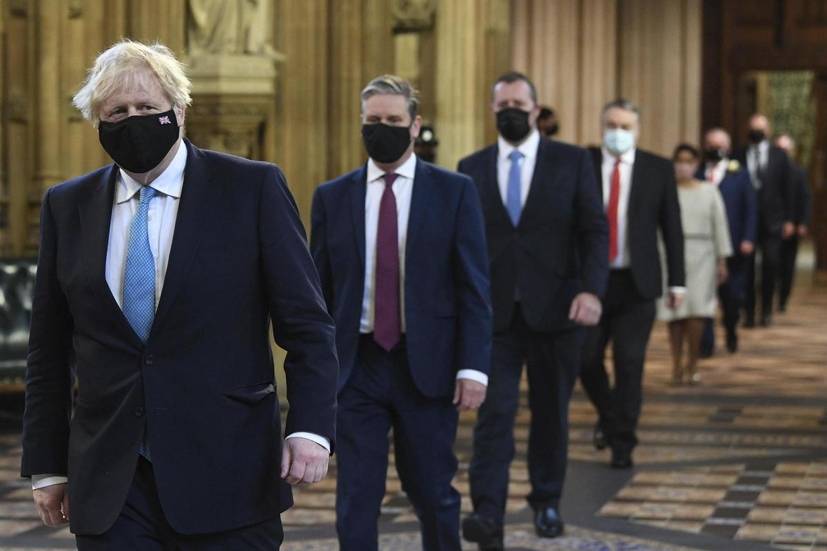 On the way to reading his government's statement: British Prime Minister Boris Johnson, followed by opposition leader Keir Starmer.