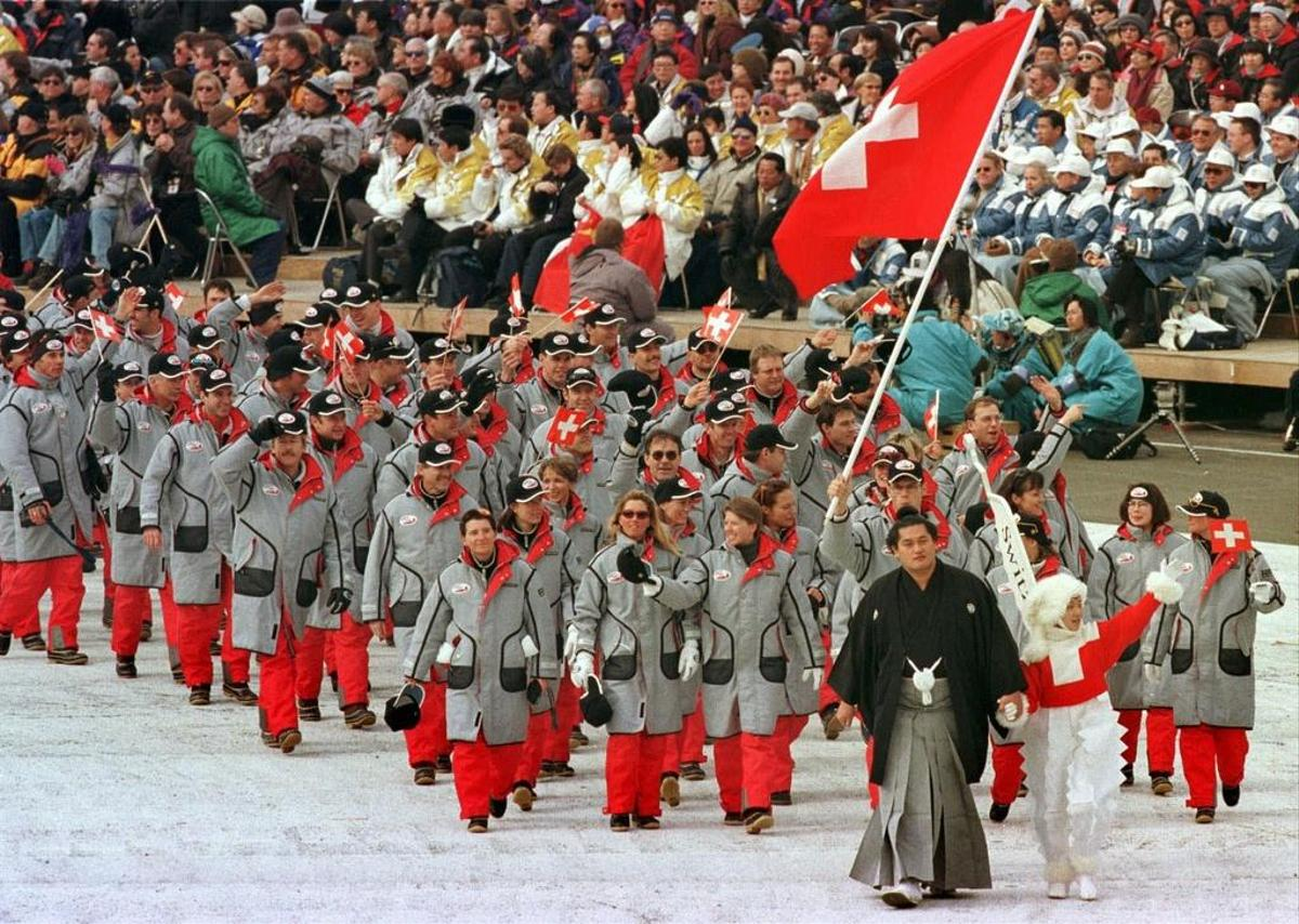 The Swiss Olympic team in red and gray at the opening of the 18th Winter Olympic Games in Nagano, Japan, in 1998.
