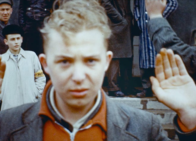 """A young German performs the Nazi salute in """"The last account."""