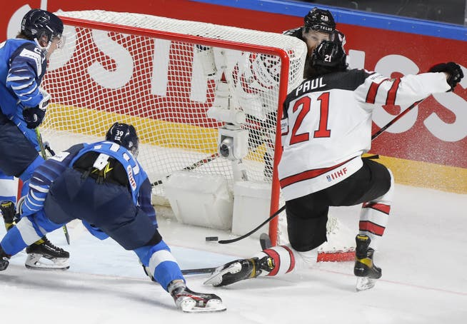 Canadian Nick Paul (right) scores the decisive goal to make it 3-2.