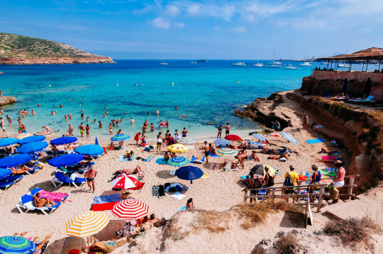 Ibiza, Balearic Islands, Spain - 08/08/2014: Tourists at Cala Compte Beach.  (Photo by Raquel Maria Carbonell Bagula/LightRocket via Getty Images)