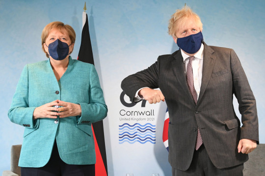 Prime Minister Boris Johnson (right) greets Chancellor Angela Merkel before a bilateral meeting during the G7 summit in Cornwall.