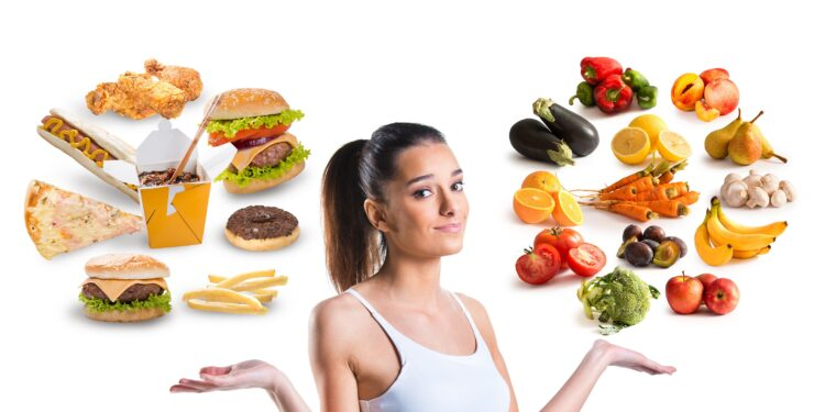 A woman floating around her head healthy and unhealthy food.