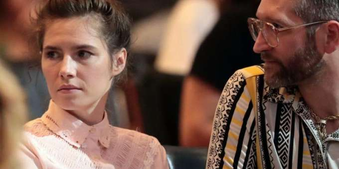 Amanda Knox and her boyfriend Christopher Robinson at a conference organized by