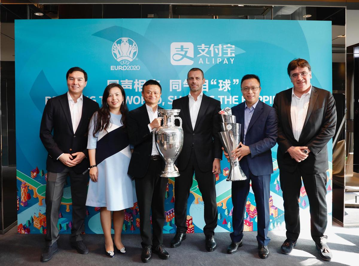 Group photo with trophies: UEFA President Aleksander Ceferin, flanked by European Championship sponsors Jack Ma, head of Chinese payment service Alipay (left), and Eric Jing, president of Ant Financial (right).