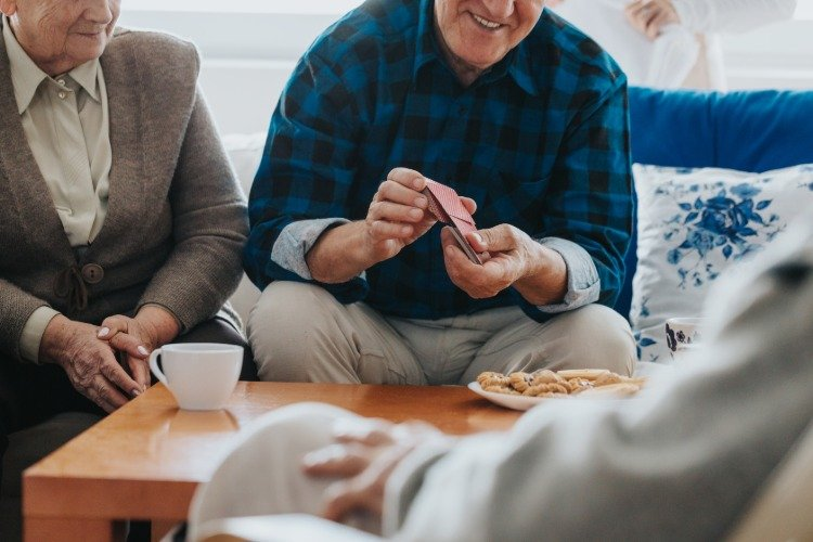 Group of old people playing cards