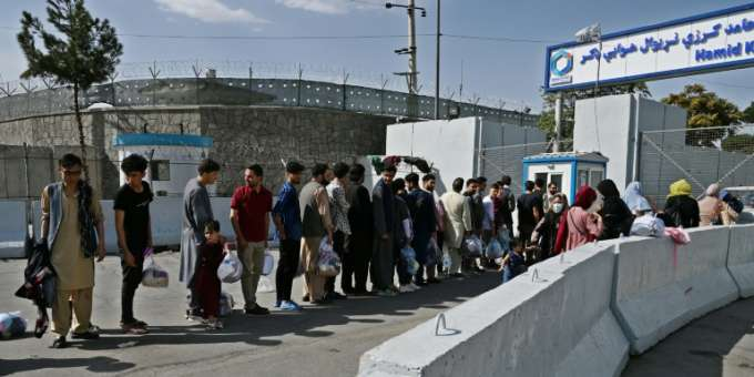 Afghans wishing to leave the country at Kabul airport
