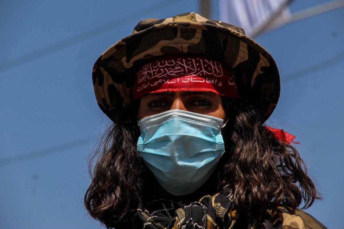 A Taliban fighter with blurred eyes at a checkpoint in Kabul.  (September 8, 2021)